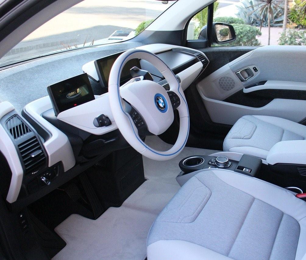 bmw car interior steering, floor mats and dashboard